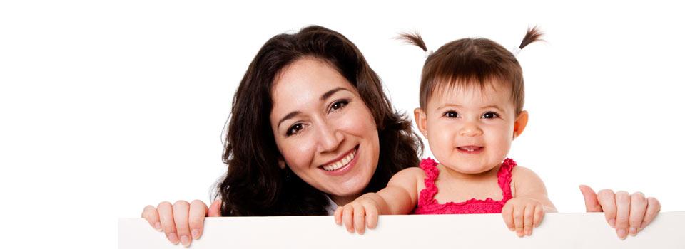 Latina nanny and baby girl smile for Sacramento nanny agency